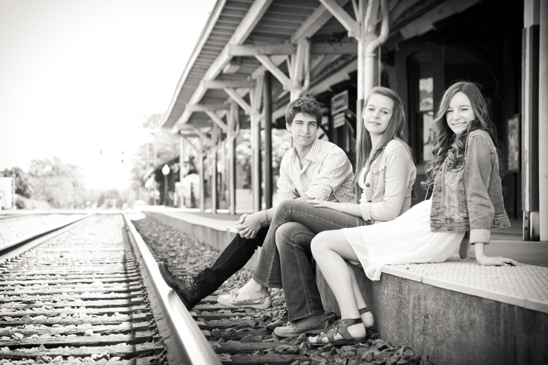 Senior Photography, Teen & Tween Photography, black and white of siblings sitting at train station