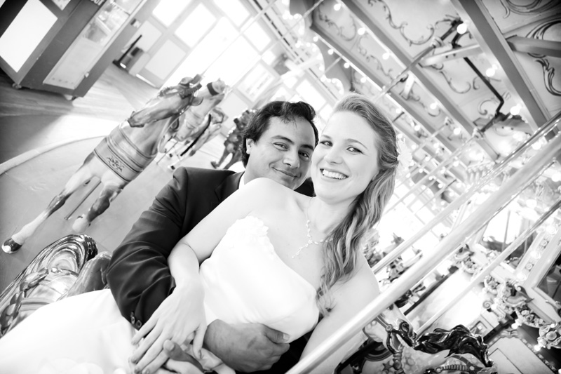 Wedding Photography and Couples Photography, black and white of bride and groom on carousel