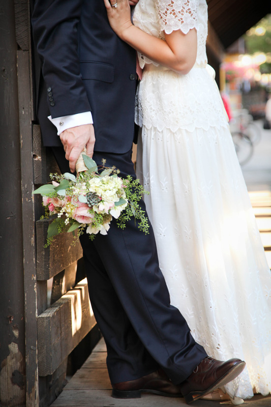Wedding Photography and Couples Photography, groom hold bride's flowers