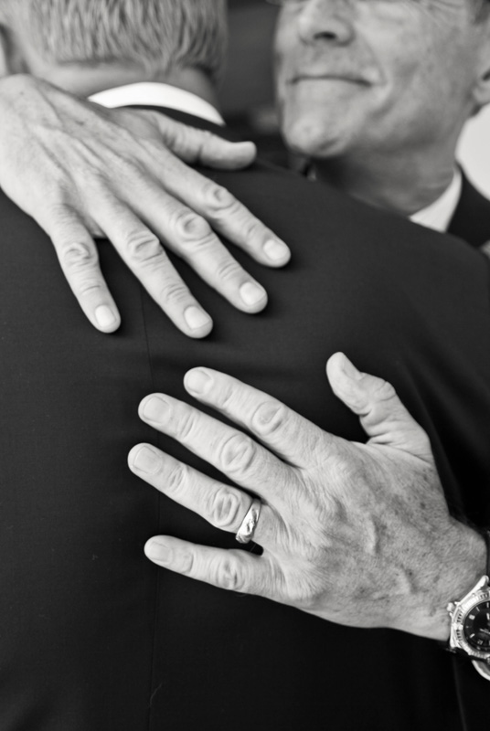 Wedding Photography and Couples Photography, fathers hugging eachother