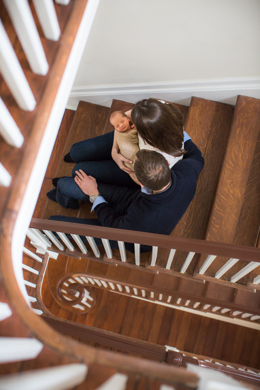 Newborn Photography & Baby Photography, couple sitting with baby on stairs