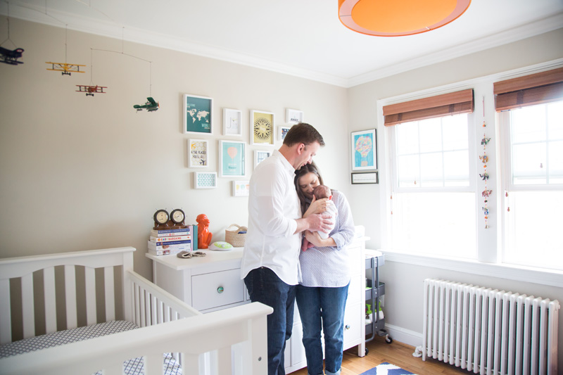 Newborn Photography & Baby Photography, couple holding baby in nursery