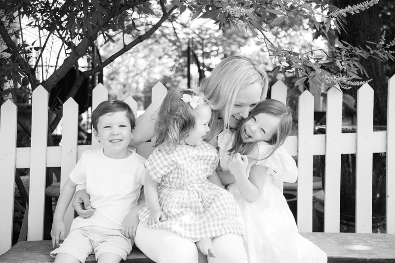 Maternity Photography and Motherhood Photography, black and white of mother with children on a bench
