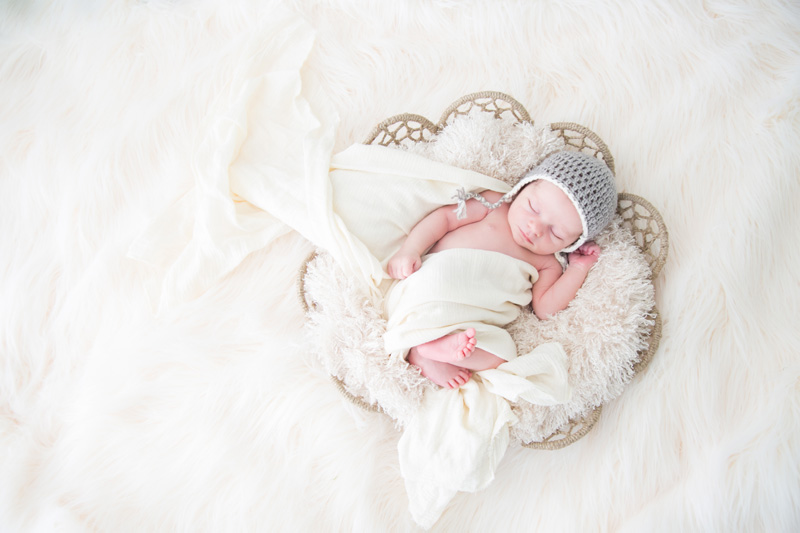 Newborn Photography & Baby Photography, baby wrapped up in white basket setup