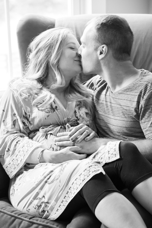 Maternity Photography and Motherhood Photography, black and white of couple sitting in chair together