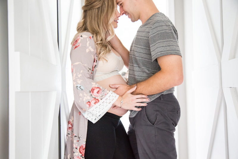 Maternity Photography and Motherhood Photography, couple cuddled up together in doorway