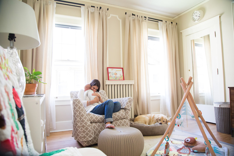 Newborn Photography & Baby Photography, mother snuggled up with baby in livingroom