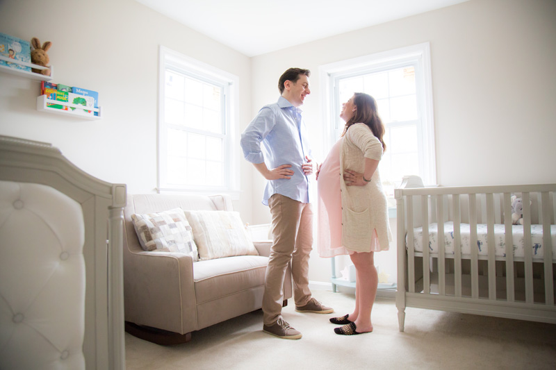 Maternity Photography and Motherhood Photography, couple standing together and smiling in baby's bedroom