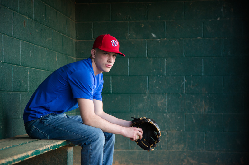 Senior Photography, Teen & Tween Photography, boy sitting in baseball dugout