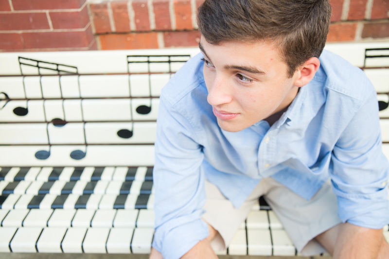 Senior Photography, Teen & Tween Photography, boy sitting on a bench painted like a piano