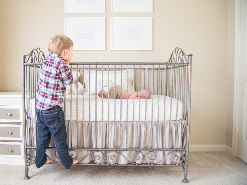 Newborn Photography & Baby Photography, big brother looking at baby in crib