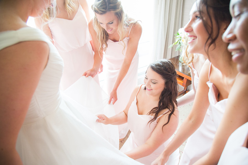 Wedding Photography and Couples Photography, bridal party fixing the bride's dress