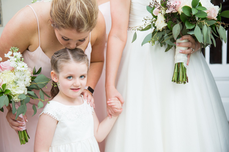 Wedding Photography and Couples Photography, bridesmaid kissing the flower girl's head